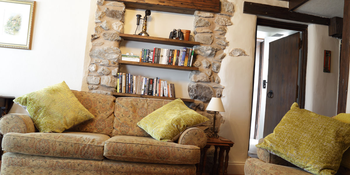 Stones walls and lounge book shelf